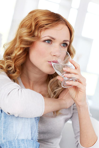 YOUNG LADY DRINKING WATER